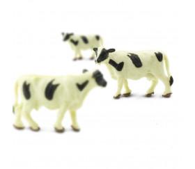 Figurine mini mini vache noire et blanche 15 x 8 x 30 mm