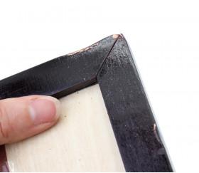 défaut sur un angle de l'échiquier en bois
